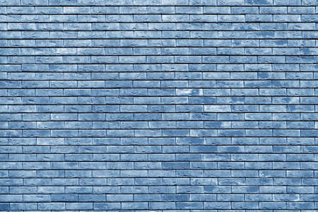Blue brick wall. Loft interior design. Blue paint of facade.