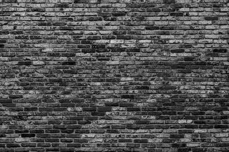 Black brick wall. Loft interior design. Architectural background. Standard-Bild