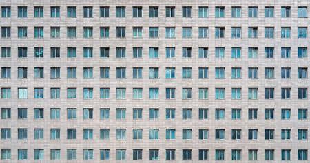 Modern office building. Windows of a multi-storey skyscraper. Rows of identical windows.