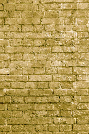 The background of the old beige brick wall for design interior and various scenes or as a background for video interviews.