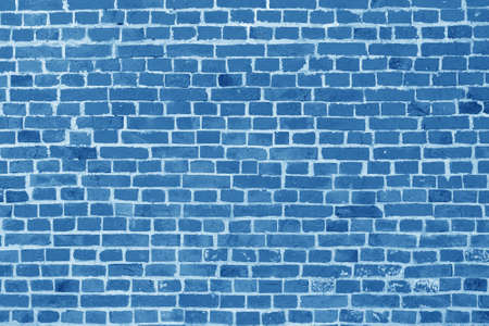 The background of the old blue brick wall for design interior and various scenes or as a background for video interviews.