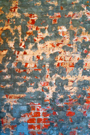 The background of the old red brick wall for design interior and various scenes or as a background for video interviews.