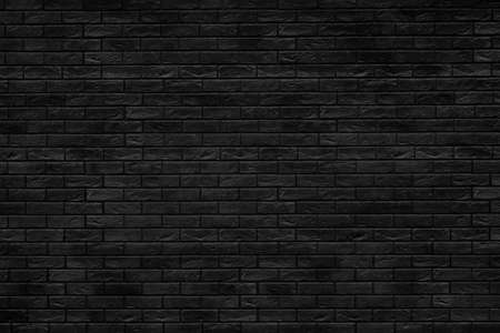 Black brick building wall. Interior of a modern loft. Background for design and interview recording.