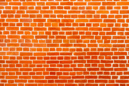 Red brick building wall. Interior of a modern loft. Background for design and interview recording.