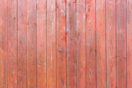 Old vintage wood planks. Red-brown wooden fence.