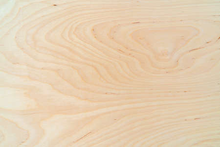 Light plywood texture. Patterned wooden background. Wood product.