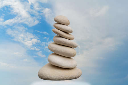 Stack of pebbles in an unstable state. A pyramid made of flat stones. Reklamní fotografie
