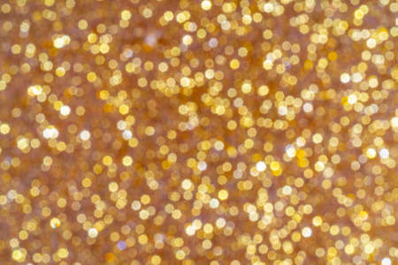 Abstract golden background. Beautiful bokeh effect. Light circles background.