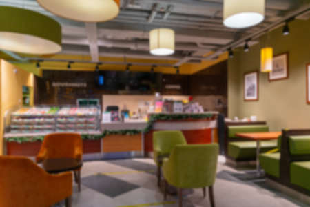 Blurred interior of a modern cafe without visitors.