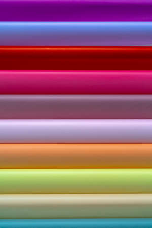 Rolls of colored wrapping paper. Abstract economic background.