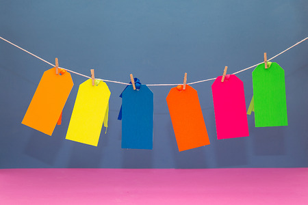 Six Colorful Paperboard Tags Hanging on a String