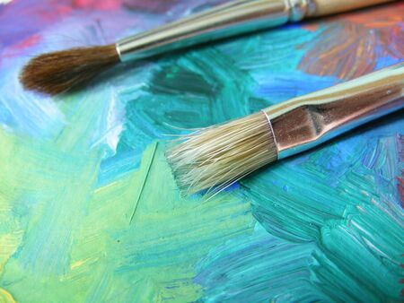 affixed: painting a colorful non-figurative thing, and then affixed to the brush and is ready Stock Photo