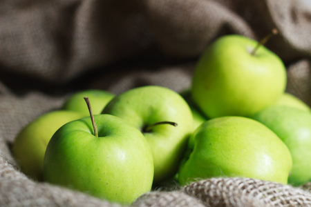 green apples: Green apples on brown suck