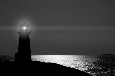 beacon: Peggys Cove lighthouse in Nova Scotia at night. Stock Photo