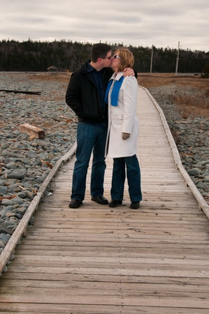Couple Kissing on the Boardwalk photo