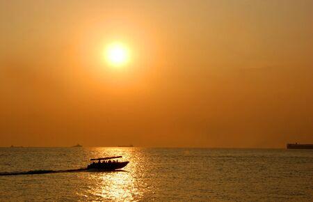 sailing under the beautiful sunset Stock Photo