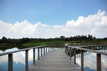 Long wooden bridge under the blue sky Stock Photo