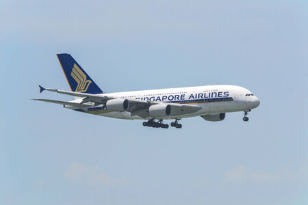 HONG KONG - August 30: Singapore Airlines Airbus A380 arrive in Hong Kong International Airport onAugust 30, 2014 in Hong Kong. Singapore Airlines was the launch customer of Airbus A380.