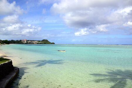 The pacific tropical island of Guam and Tumon bay with clear water and blue sky