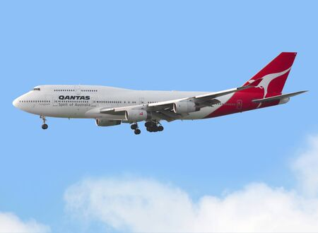 Qantas Airways aircraft is taking off in Hong Kong
