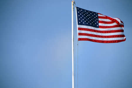 American flag in the blue sky Stock Photo