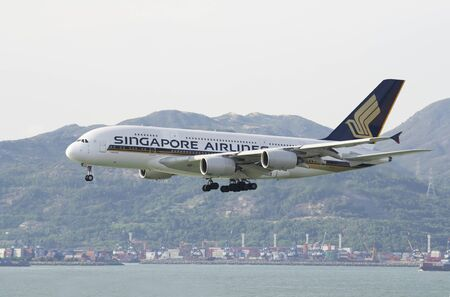 HONG KONG  May 28: Singapore Airlines Airbus A380 arrive in Hong Kong International Airport on May 28 2014 in Hong Kong. Singapore Airlines was the launch customer of Airbus A380 currently the worlds largest passenger aircraft.