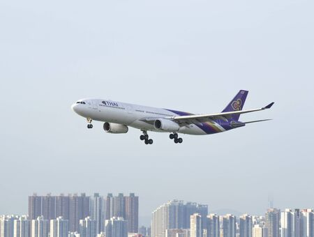 HONG KONG  MAY 28: Thai Airways Airbus 330 departure from Hong Kong International Airport on May 28 2014 in Hong Kong. Thai Airways is the national flag carrier of Thailand. Editorial