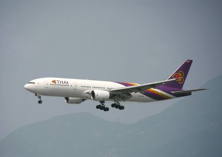 HONG KONG – March 19: Thai Airways Boeing 777 departure from Hong Kong International Airport on March 19, 2014 in Hong Kong. Thai Airways is the national flag carrier of Thailand