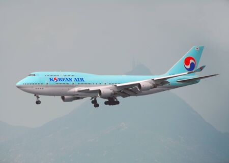 HONG KONG – March 19: Korean Air Boeing 747 arrive in Hong Kong International Airport on March 19, 2014 in Hong Kong. Korean Air is the largest airline and flag carrier of South Korea.