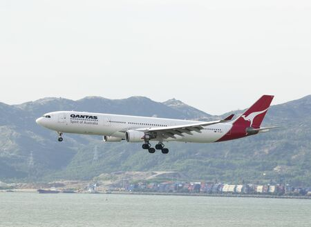 HONG KONG - May 28: Qantas Airways Airbus 330 arrive in Hong Kong International Airport on May 28, 2014 in Hong Kong. Qantas Airways is the flag carrier airline of Australia.