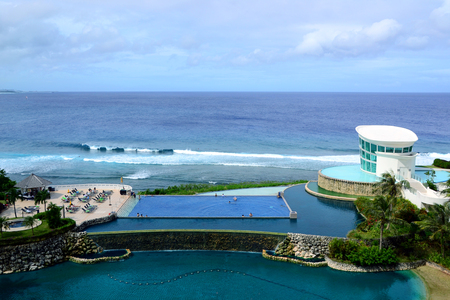 Beautiful swimming pool align the sea level with seaview of resort