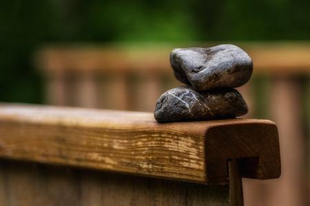 Stones on a wooden bridge, symbol for rest