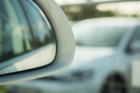 Looking into the outside mirror of a car Stock Photo