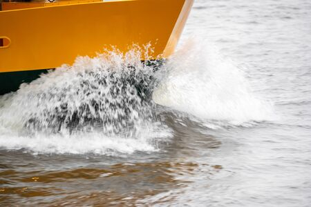 A boat in full speed over the water