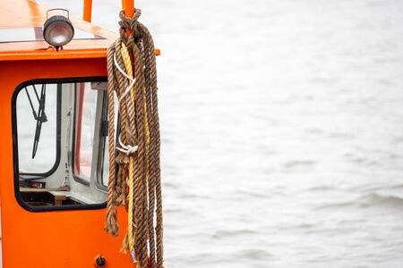 Close-up, ropes hang on a boat cabin Stock Photo