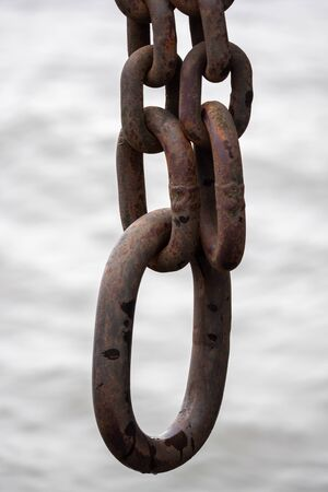 Close-up, a heavy anchor hangs on the ship