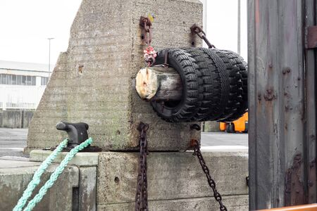 Tires hanging on the harbor to protect the boats