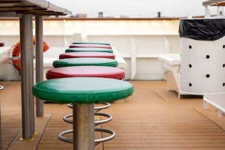 Leather-covered chairs on the deck of a ship