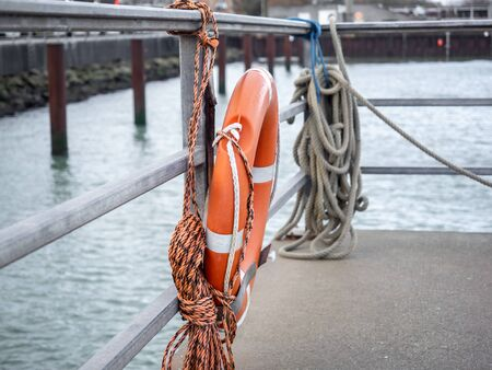A lifebuoy hangs ready at the harbor