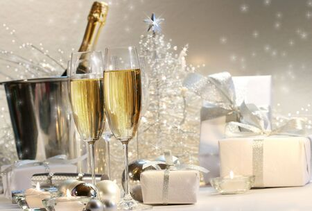 Champagne glasses with silver shimmering lit background Stock Photo - 2522478
