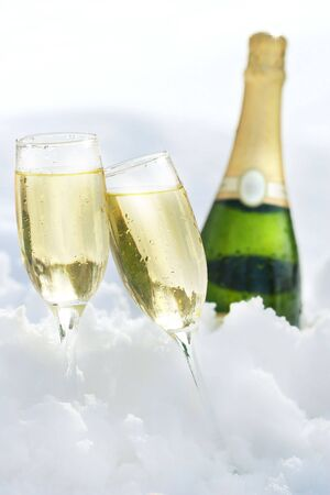 jubilation: Champagne glasses and bottle in the snow