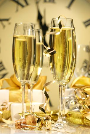 Glasses of champagne ready to celebrate at the stroke of midnight New Years Eve Stock Photo