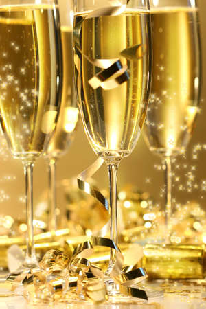 Golden champagne sparkle with fluted glasses and party ribbons Stock Photo - 2522487
