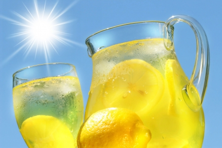 Cool lemonade on a hot summer day photo