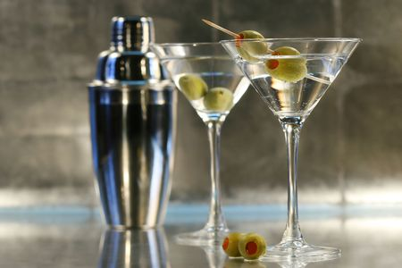 Martinis with olives and shaker on bar Stock Photo