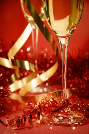 Fluted champagne glasses and ribbons on red background Stock Photo - 2522454