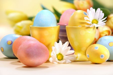 Colorful Easter eggs with flowers on the counter