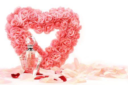 perfume bottle: Heart of roses with perfume bottle on white background