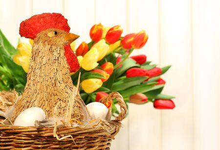 Straw chicken in wicker basket with eggs