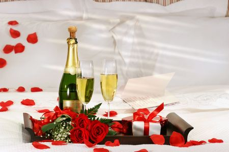 luxury bedroom: Champagne in bed to celebrate Valentines Day Stock Photo